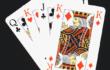 Skat, 4 Karten gefächert mit Caro König im Vordergrund